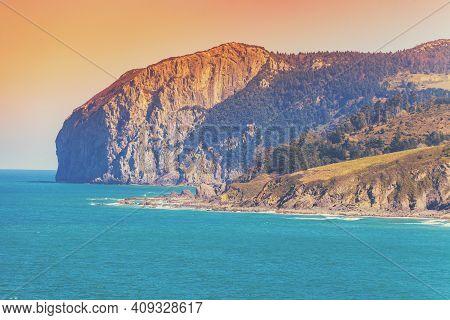 Rocky Seashore Near The Island Of Gaztelugatxe. Bay Of Biscay, Basque Country, Spain