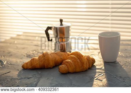 Breakfast With Croissant And Moka Pot. Morning Meal And Breakfast Concept.