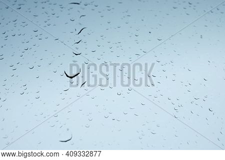 Water Drops On Glass. Raindrops On The Windshield Of The Car. Melted Snowflakes On The Glass. Beauti