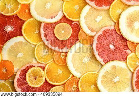 Citrus Fruits Cut Into Round Pieces: Orange, Grapefruit, Lemon, Tangerine. Ripe And Juicy Fruits, To