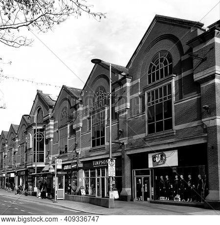 LONDON, UK - 21st February 2021: High street shops in Barking, east London. Taken in black and white.