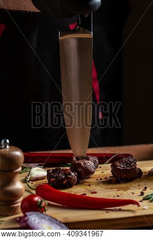 The Chef In Black Gloves Cuts With Knife The Beef Fillet On The Kitchen, Restaurant Menu, Dieting, C