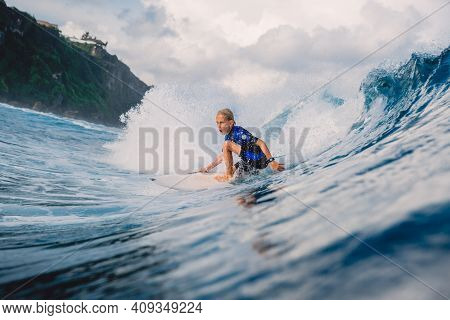 January 21, 2021. Bali, Indonesia. Young Surfer Ride At Ocean Wave On The Surfboard.