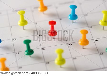 Everyday Plans Concept. Cropped Closeup View Photo Of Many Lot Pushpins Attached To The Calendar Wit
