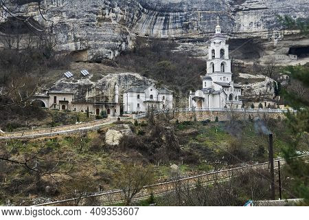 Bakhchisarai, Crimea - January 24, 2021: Bell Tower And Outbuildings Of Assumption Monastery Of The