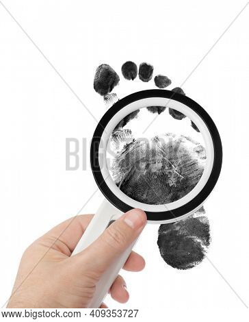 Magnifying glass in hand and foot print isolated on white background