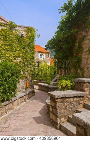 Street in Island Sveti Stefan - Montenegro - architecture and nature background