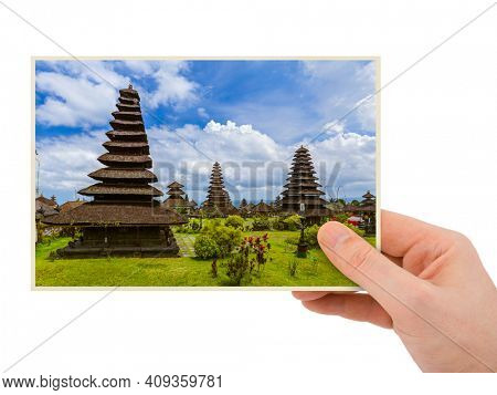 Hand and Besakih temple in Bali Indonesia (my photo) isolated on white background