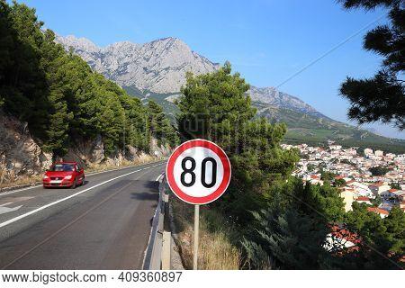 The Adriatic Highway (croatian: Jadranska Magistrala) Near Makarska, Croatia. Speed Limit Sign.
