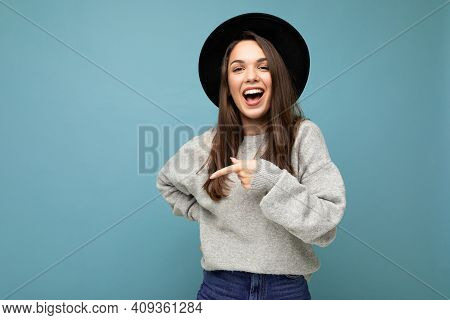 Photo Of Beautiful Brunette Happy Joyful Young Woman Directing Finger To The Side With Copy Space, D