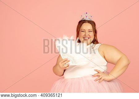 Close Up. Beautiful Plump Caucasian Plus Size Model In Fairys Outfit Isolated On Pink Studio Backgro