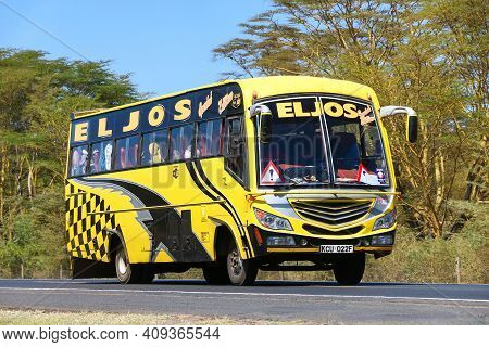 Rift Valley Province, Kenya - January 31, 2021: Bright Yellow Intercity Coach Bus At The Interurban