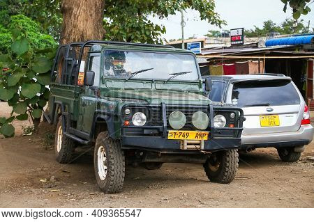 Arusha, Tanzania - February 6, 2021: Old Pickup Truck Land Rover Defender In The City Street.