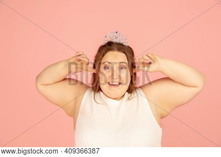 Close Up. Beautiful Plump Caucasian Plus Size Model In Fairys Outfit On Pink Studio Background. Conc