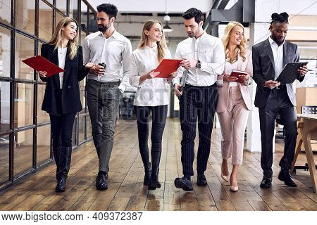 Multiracial Young Creative People In A Modern Office. Group Of Young Businessmen Working Together. S