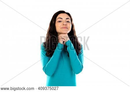 Adorable teenage girl with blue sweater isolated on a white background