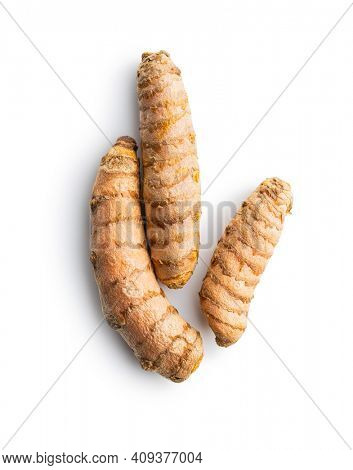 Indian turmeric root. Turmeric spice. Yellow turmeric isolated on white background.