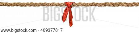 Long tug of war rope pulled tight, with red ribbon tie. Concept of conflict, competition, or rivalry. Isolated on white.