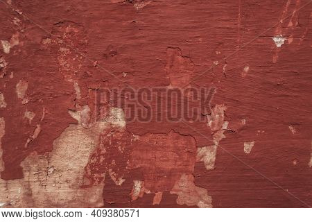 Multicolored Background:concrete Surface With Peeling And Cracked Brown Paint Natural Defects Scratc