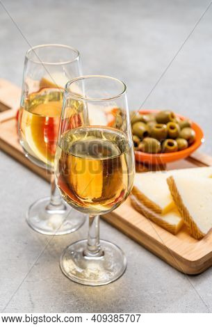 Glasses Of Dry Fino Sherry Wine Served With Spanish Tapas, Manchego Cheese, Green Olives, Cheese Cra