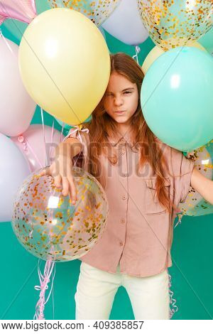 1 White Girl 10 Years Old With Pink, Yellow, Blue Balloons Smiles