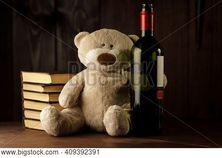 Alcohol And Child Abuse. Teddy Bear As A Symbol Of Childs Safety And Bottle Close-up