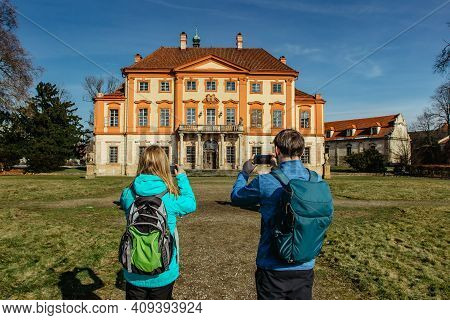 Tourists Backpackers Taking Pictures Of Old Abandoned Baroque Castle In Central Bohemia,czech Republ
