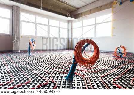 Floor heating and electrical outputs in a new building. Interior design and finishing industry. Office and apartment
