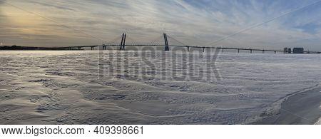 Winter Panorama Of The Guy Three-flying Pilonny Bridge Through The Ship Waterway At Sunset, Russia,