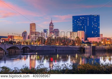 Indianapolis, Indiana, USA skyline on the White River at dusk.