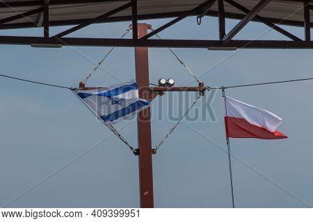 Israeli And Polish Flag On The Mast Of An Israeli Boat Carrying Polish Tourists On The Sea Of Galile