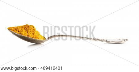 Indian turmeric powder. Turmeric spice. Ground turmeric isolated on white background.