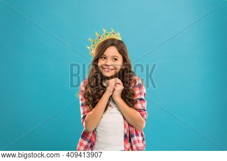 Girl Cute Baby Wear Crown While Stand Blue Background. Become Princess Concept. Every Girl Dreaming