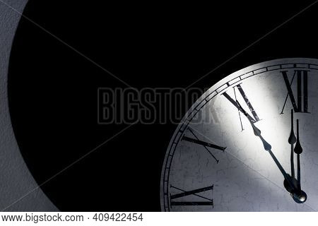 Vintage Wall Clock With Roman Numerals Showing Five Minutes To Midnight As A Symbol For Time Running