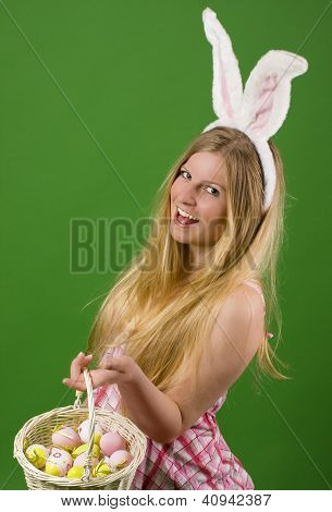 Smiling Young Woman With Easter Eggs In Basket