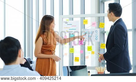 Business Meeting For Presenting Business Plan Information At Office, Asian Woman Explaning Business