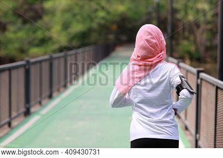 Rear View Portrait Sporty Young Asian Muslim Woman In Sportswear Jogging Outdoor For Marathon Traini