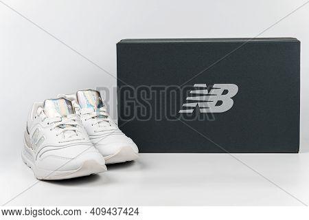 Kiev, Ukraine - January 03, 2021: White Women's Casual Sneakers From New Balance Brand On A Light Ba