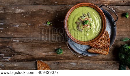 Traditional Recipe Of Broccoli Cheese Soup With Vegetables In A Bowl With Toast, Homemade Healthy Or