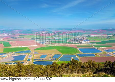 Jezreel Valley in the Lower Galilee, Israel. Warm winter in israel. Picturesque agricultural fields cover the entire valley