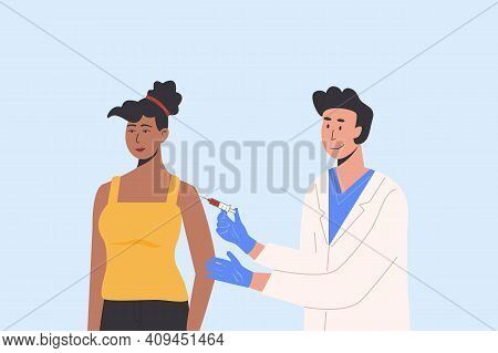 Male Doctor In A Medical Gown And Gloves Gives Vaccine Shot To African Female Patient. Vaccination C