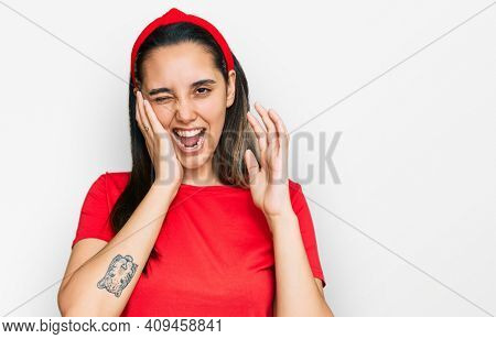 Young hispanic woman wearing casual clothes covering ears with fingers with annoyed expression for the noise of loud music. deaf concept.