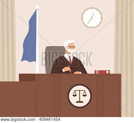 Serious Court Judge Sitting At Bench, Listening And Taking Notes In Courtroom With Flag. Legal Autho