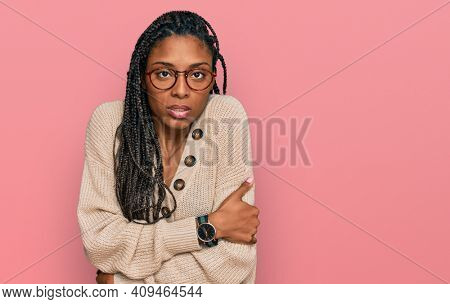 African american woman wearing casual clothes shaking and freezing for winter cold with sad and shock expression on face
