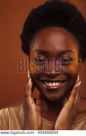 Pretty Young African American Woman With Curly Hair Posing Cheerful Gesturing On Brown Background, L