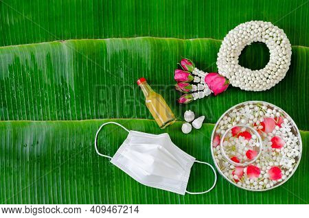 New Normal Songkran Festival Background With Face Mask, Jasmine Garland, Flowers In Water Bowl, Scen