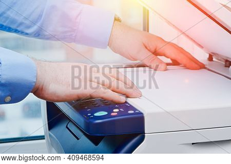 Business Man Hand Press Button Printer Panel To Make A Copy Of The Document In The Office. Multifunc
