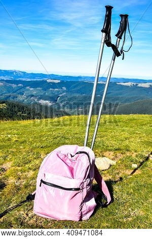 Trekking Poles At Top Of Mountain With Beautiful View Of Autumn Mountains. Natural Background. Hikin