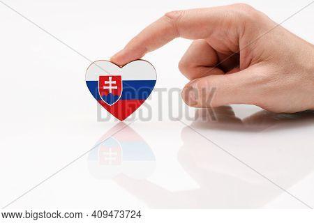 Flag Of Slovakia. Love And Respect Slovakia. A Man's Hand Holds A Heart In The Shape Of The Slovakia