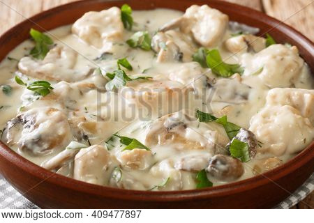 Ciulama De Pui Is A Romanian Creamed Chicken Dish With Mushrooms Closeup In The Bowl On The Table. H